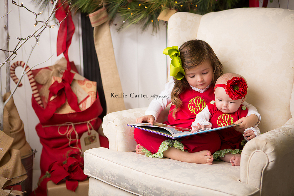 studio picture of sisters reading book together
