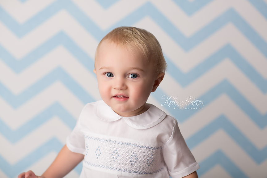 One year old baby boy photographed by Kellie Carter.