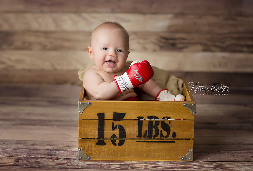 4 month old baby with Boxing gloves